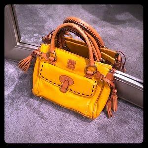 Dooney & Bourke all leather gold satchel.